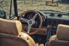 Close up on Old Vintage steering wheel and cockpit of Apha Romeo Royalty Free Stock Photos