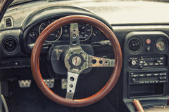 Close up on Old Vintage steering wheel and cockpit Stock Photos
