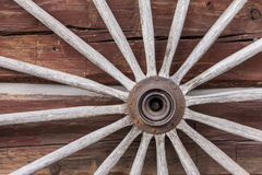 Close up of old wagon wheel. Stock Images