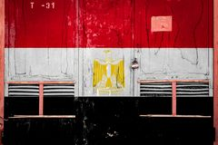 Close-up of old warehouse gate with national flag stock illustration