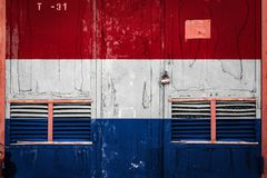 Close-up of old warehouse gate with national flag. Of Netherlands. Concept of Netherlands export-import, storage of goods and national delivery of goods. Flag royalty free illustration