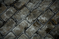 Close-up old weathered cobble stone Royalty Free Stock Images