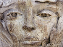 Close-up of Old Weathered Statue. Weathered Statue of a Woman's Face stock photo