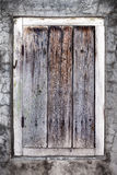 Close up of an old weathered wooden door. Royalty Free Stock Image