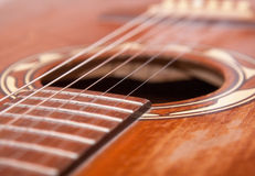 Close up of a old western guitar Stock Photography