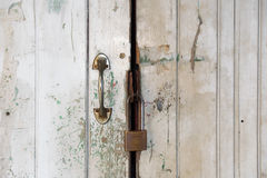 Close up Old white door and master key lock Stock Photos