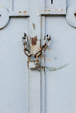 Close up of old white gate with lock Royalty Free Stock Photo