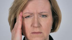 Close up of old woman face gesturing headache, stress stock footage