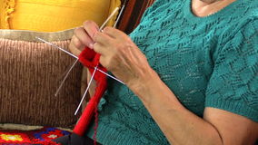 Close up of old woman hands knit socks with five needles stock video footage