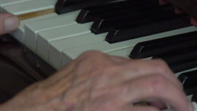 Close up of old woman hands playing the piano stock footage