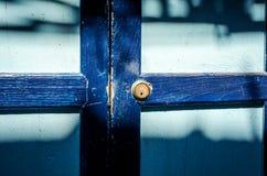 Close up of an old wood blue door. Sun shade Stock Photos