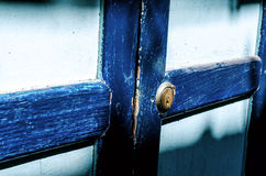 Close up of an old wood blue door. Sun shade Stock Images