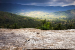 Close up old wood table top with blur mountain Stock Images