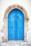 Close up of an old wooden blue door. Stock Images