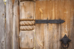 Close-up of old wooden door on metal hinges Royalty Free Stock Image