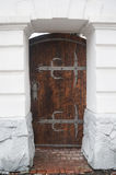 Close up old wooden door with metal loops Royalty Free Stock Photos