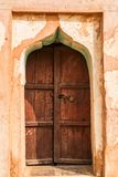 Wooden door in Orchha Fort, India. Close up old wooden door in Orchha Fort in Imdia Stock Photos
