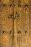 Close up - Old wooden door with ornaments Stock Image