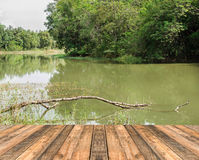 Close up old wooden floor and the lagoon Royalty Free Stock Photography