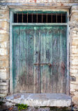 Close up of an old wooden green door. Royalty Free Stock Photo