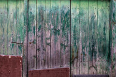 Close up of an old wooden green door. Stock Photo