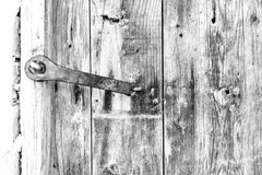 Close-up, of an old wooden rustic door in black and white. Vintag Royalty Free Stock Photography