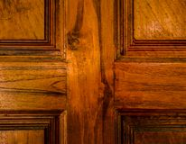Close up old wooden teak door as cross texture. Abstract. Hight contrast , vintage for background Stock Image