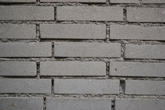 Close up of old worn brick wall background. Aged dirty stone wall textured. Vintage effect Royalty Free Stock Photo