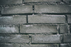 Close up of old worn brick wall background. Aged dirty stone wall textured. Vintage effect Royalty Free Stock Photos