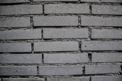 Close up of old worn brick wall background. Aged dirty stone wall textured. Vintage effect Stock Image