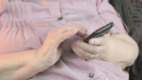 Close up of old wrinkled hands holding smartphone stock video footage