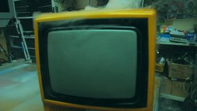 Old yellow retro TV. Close-up - old yellow retro TV in smoke stock video