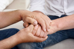 Close up of old and young men hands Stock Images