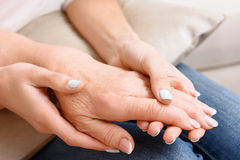 Close up of old and young women hands Stock Image