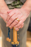 Close up of older ladies hands on umbrella handle. Royalty Free Stock Images