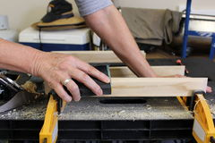 Close up of older woman sanding timber Stock Image