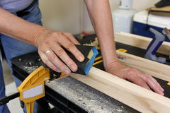 Close up of older woman sanding timber 4 Stock Photo