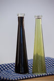 Close up of olive oil bottle on napkin Stock Images