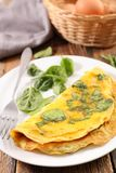 Omelet with spinach. Close up on omelet with spinach stock photography