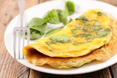 Omelet with spinach. Close up on omelet with spinach stock images