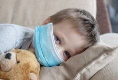Free Close-up On A Little Boy In A Medical Mask On A Sofa With A Teddy Bear. Pandemic, Coronovirus, Infection. Sick Children Royalty Free Stock Photography - 183813837