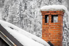 Free Close Up On Red Brick Chimney In Winter Scenery With Snow On A Rooftop Royalty Free Stock Photo - 106389095