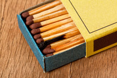 Close-up of one burn match in a matchbox Stock Photos