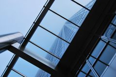 Close-Up of One Canada Square Tower. Looking straight up the side of the One Canada Square skyscraper through a glass and steel canopy, in Canary Wharf. The sky Royalty Free Stock Photography
