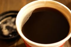 Close up of one cup of hot coffee on table at food court. In Taiwan stock images