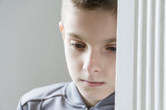 Close up of one depressed child in gray jacket Stock Images