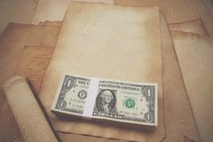 Close up of one dollar bill and old papers Royalty Free Stock Images