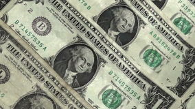 Close up of one dollar bills. Rotating stock video footage