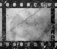 Old vintage retro 35 mm grunge film frame. Close up one frame of old vintage grunge retro styled classical 35 mm film strip isolated on white background Stock Images