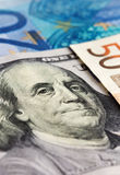 Close-up of one hundred dollar note. With euro notes Royalty Free Stock Images